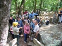 heather-carey-talks-to-the-groups-at-the-steps-leading-up-to-the-millstone-bluff-village-and-rock-art-panels